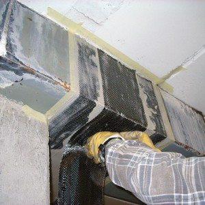 Dettaglio di restauro strutturale con materiali compositi FRP